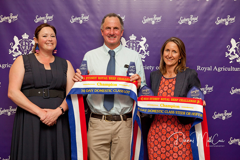 Liz Pearson from Angus Australia and Ben & Wendy Mayne from Texas Angus with their Champion trophies