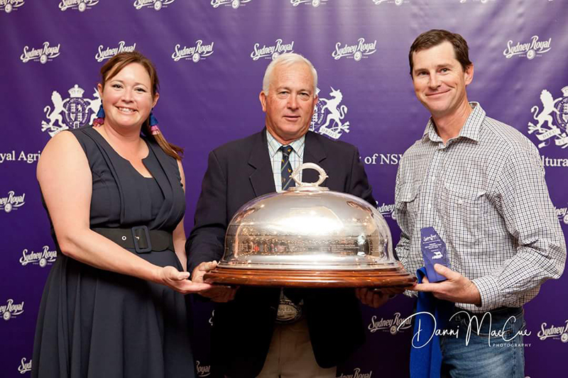 Nathan Charters from the Charters Family receiving the 100 Day Export Team Taste Test Trophy and the RAS Perpetual Consumer Trophy for Champion Export Taste Test Carcase with Liz Pearson from Angus Australia and Greg Watson from the Royal Agricultural Society of NSW. Donated by Mr John Carter