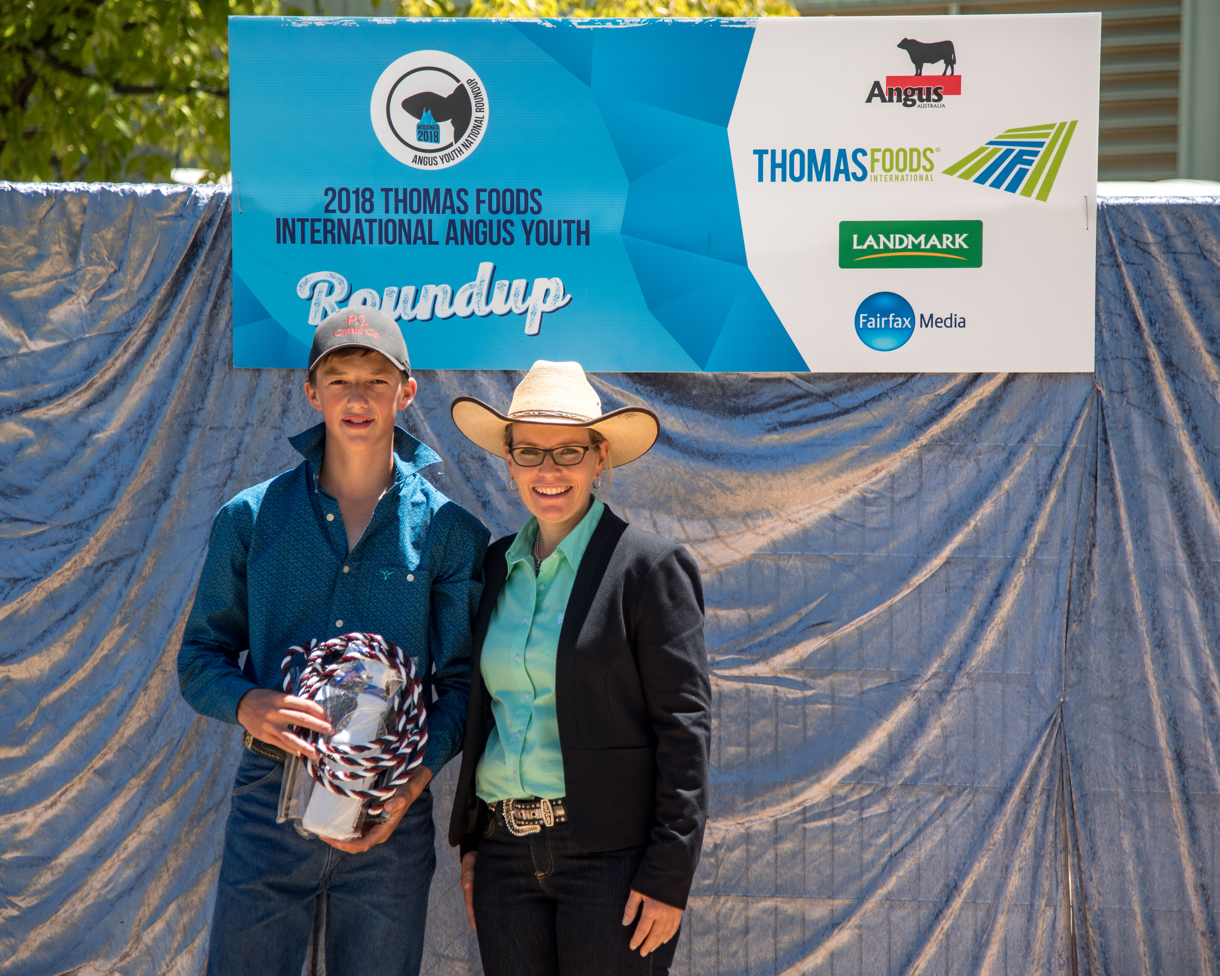 Fiona McWilliam judging the paraders at the 2018 Thomas Foods International Angus Youth Roundup with Grand Champion Parader, Lochie McLauchlan. Image Emily H Photography