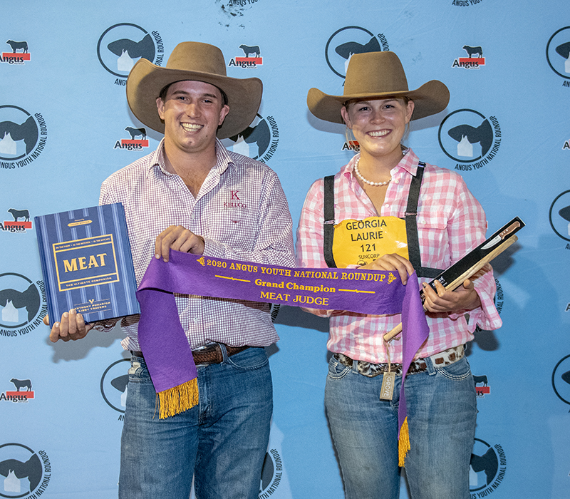 Marshall Arnold, Kell Co Livestock Agents, presenting the Grand Champion Junior Judge Georgia Laurie